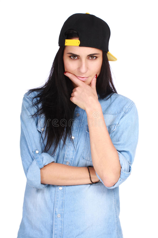 Portrait of young woman in cap posing on white. Portrait of young woman in jeans shirt and cap posing on white background stock photography
