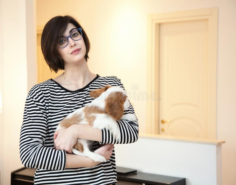 Young woman with puppy royalty free stock image