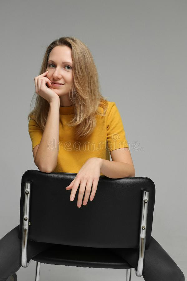 Portrait of young woman on chair royalty free stock images