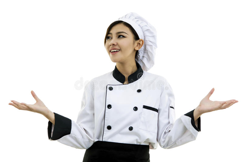 Portrait of young woman chef on white background royalty free stock photography