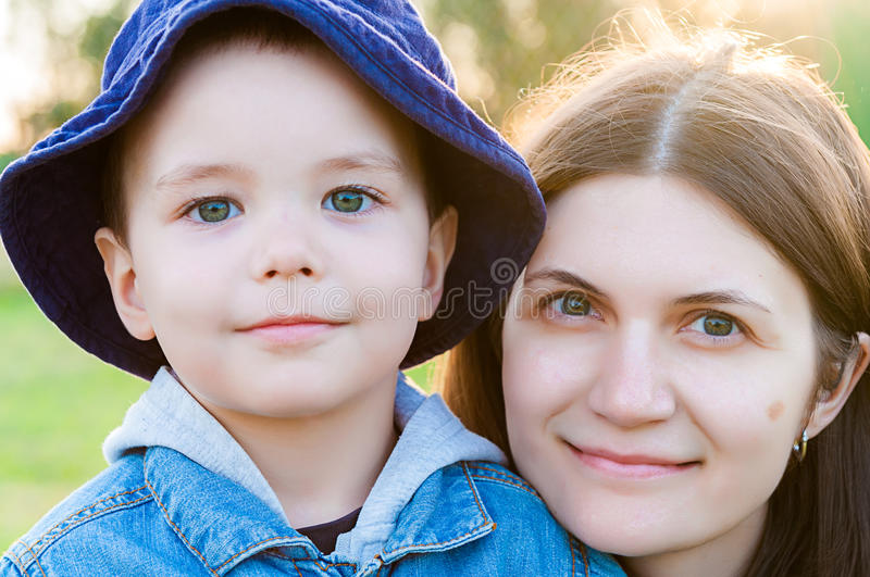 Portrait of young woman and child royalty free stock photography