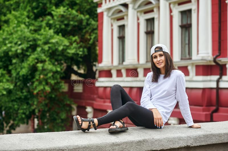 Portrait of a young woman on a city street royalty free stock image