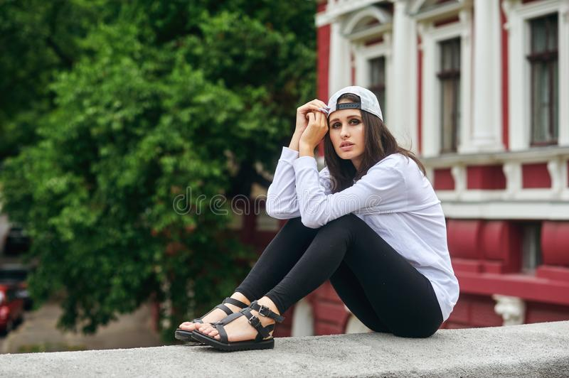 Portrait of a young woman on a city street royalty free stock images