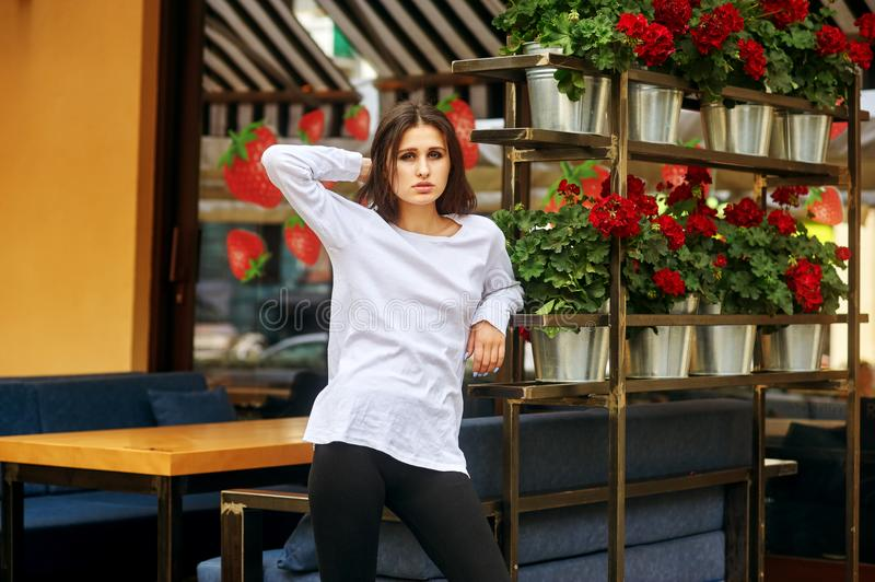 Portrait of a young woman on a city street stock images