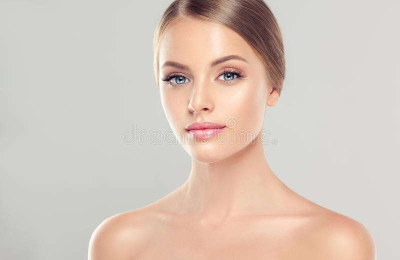 Portrait of young woman with clean fresh skin and soft, delicate make up. stock image