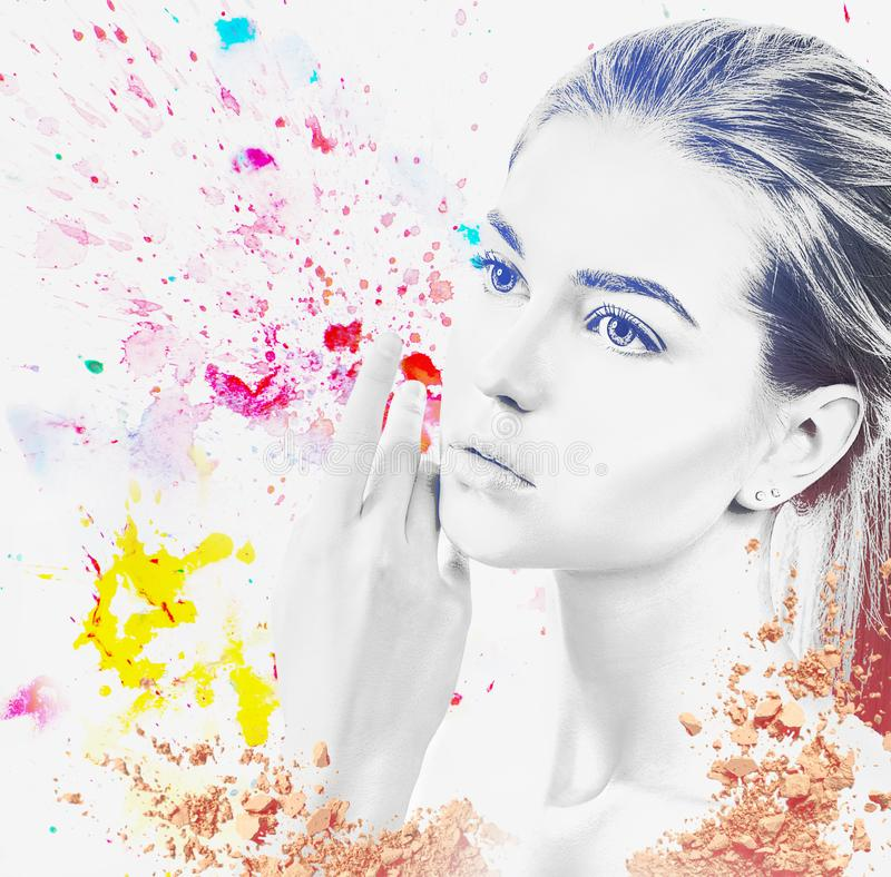 Portrait of young woman and colorful paint blots. Isolated on white stock photo