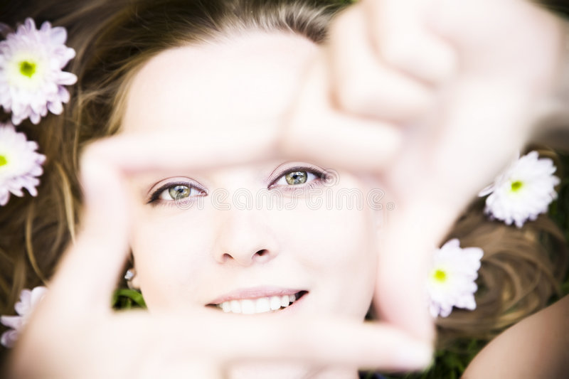 Portrait of young woman creates a frame royalty free stock image