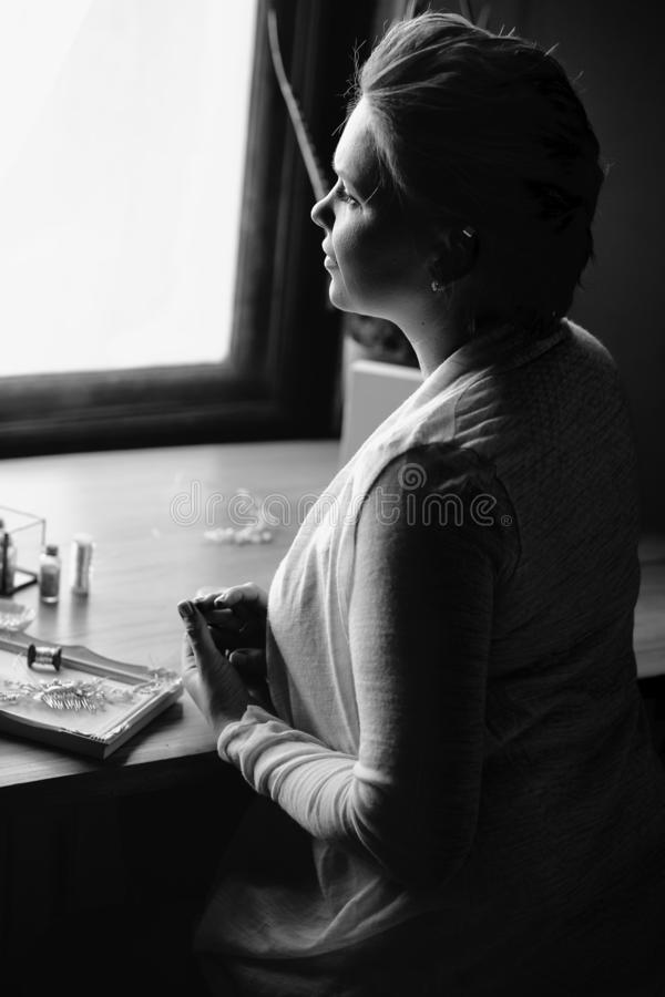 Portrait of woman, creating wedding jewelry, workplace of decorator. Woman`s hands in a process of creation stock photos