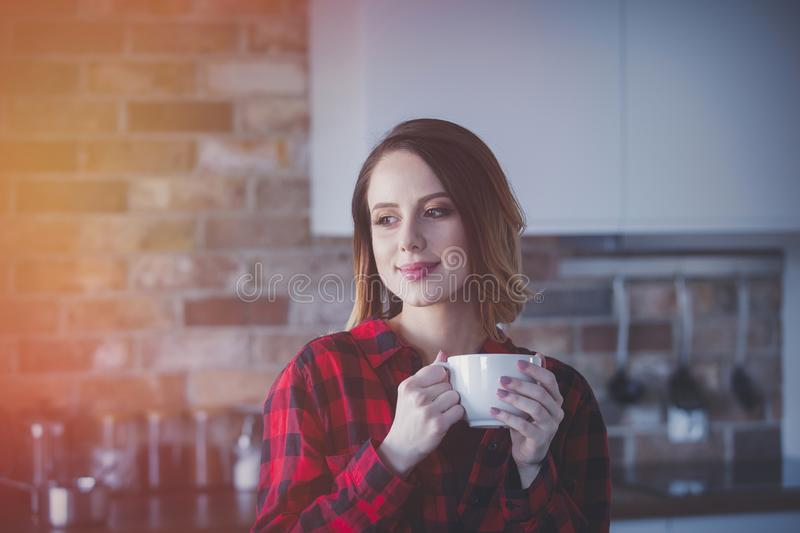 Portrait of young woman with cup of tea or coffee royalty free stock photography