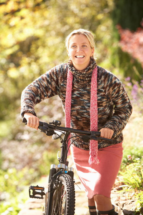 Download Portrait Of Young Woman With Cycle In Autumn Park Stock Image - Image: 15542551