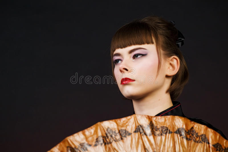 Download Portrait Of Young Woman On A Dark Background Stock Photo - Image: 12526232