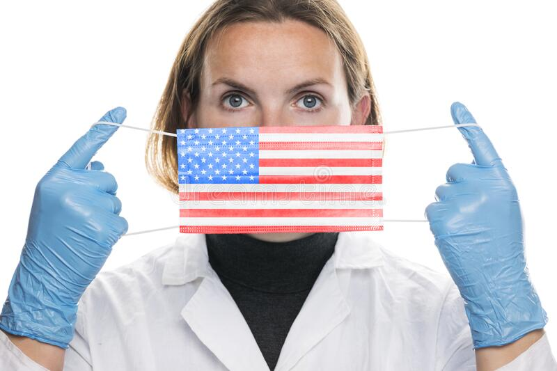 Portrait of a young woman doctor with medical protective mask with the image of the flag of United States of America USA. Crisis. Quarantine, recession and royalty free stock photo