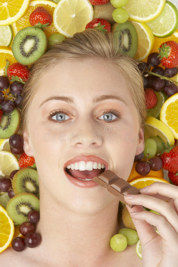 Portrait Of Young Woman Eating Chocolate stock photo