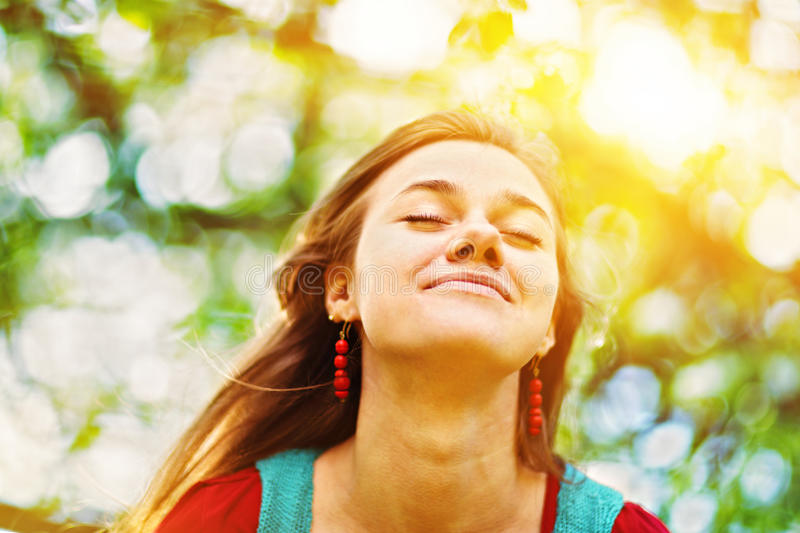 Portrait of a young woman enjoying nature and sunlight royalty free stock photo