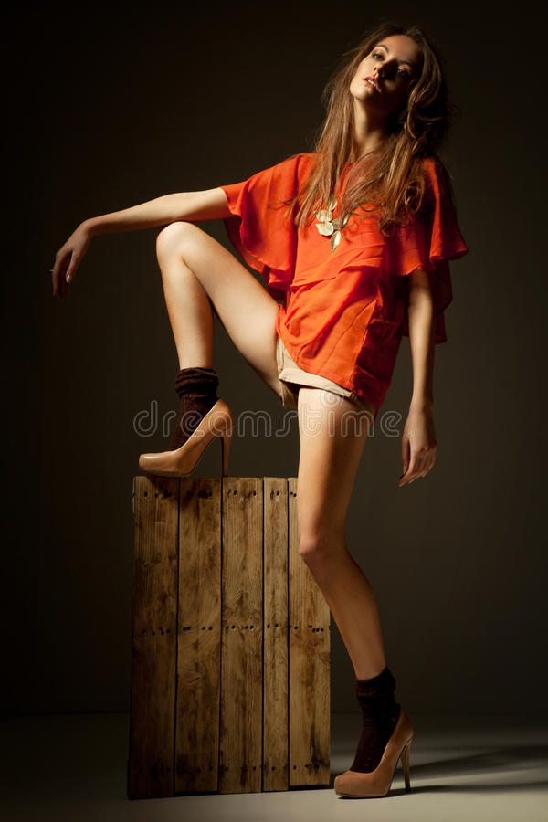 Portrait of a young woman in fashion clothes in studio royalty free stock images