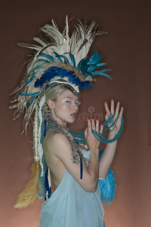 Download Portrait Of Young Woman In Feathered Outfit Over Colored Background Stock Photo - Image: 29674542
