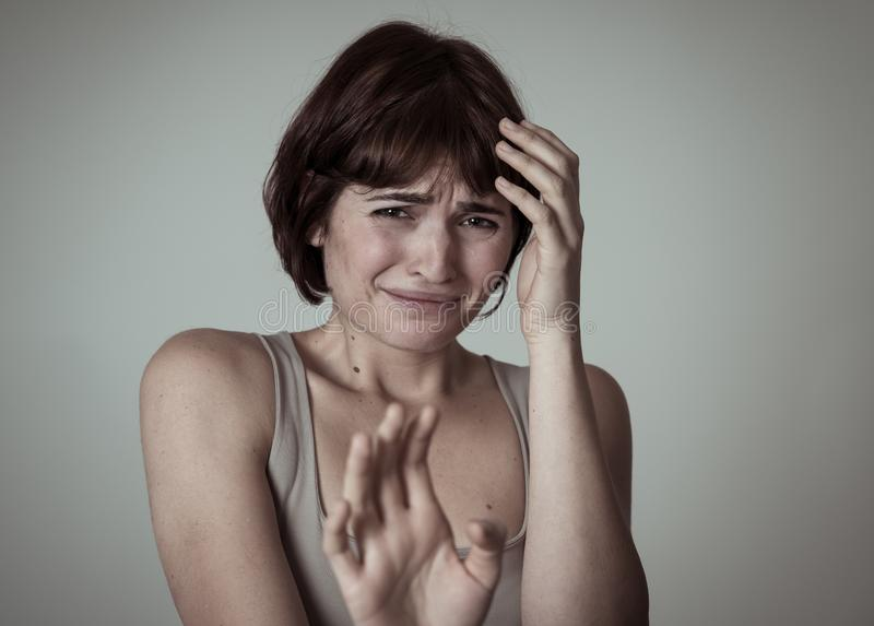 Portrait of a young attractive woman looking scared and shocked.Human expressions and emotions stock images