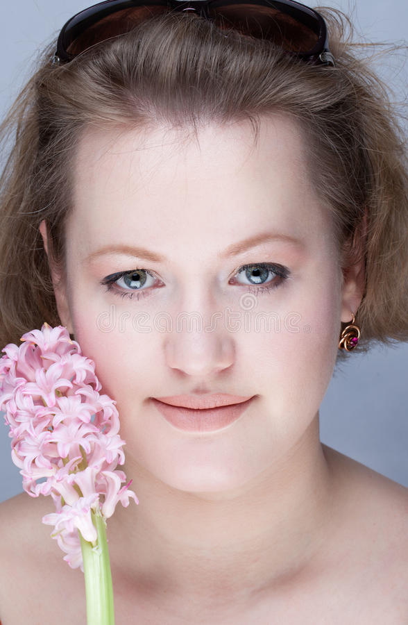 Portrait of a young woman with flower royalty free stock photos