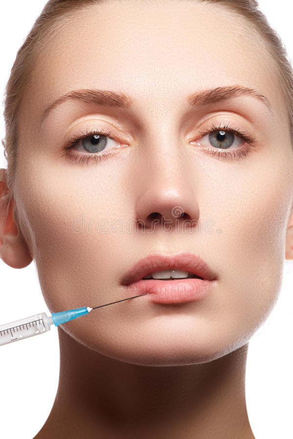 Portrait of young woman getting cosmetic injection. Beauty royalty free stock images