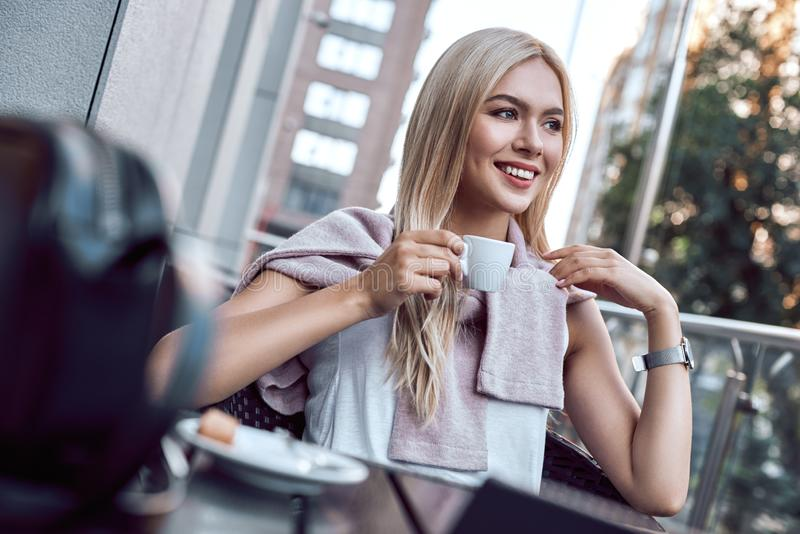 Portrait young woman with glasses drinking coffee in cafe. Relax stock photo