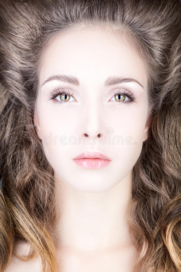 Portrait of a young woman with hair volume. royalty free stock photography