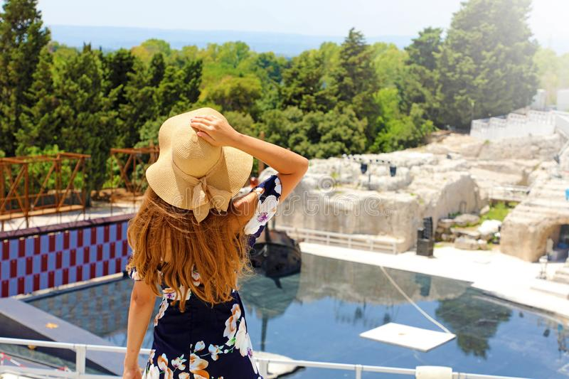 Portrait of young woman with hat in Syracuse Siracusa Greek theatre, Sicily, Italy stock image