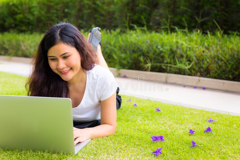 Portrait of young woman having fun with computer laptop, Outdoor royalty free stock photo