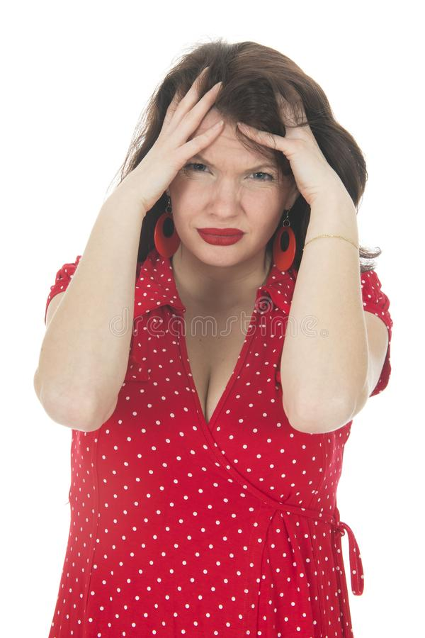 Portrait young woman with head ache. Portrait young woman in red dress having head ache isolated over white background stock photography