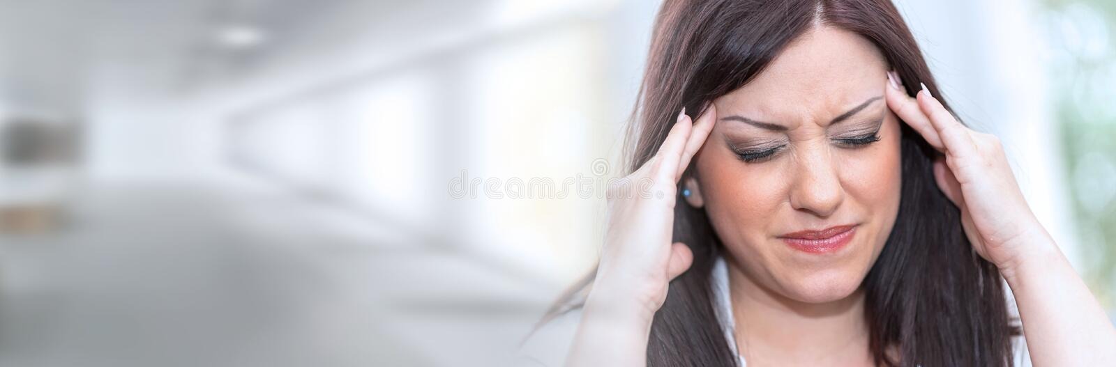 Portrait of young woman with headache; panoramic banner. Portrait of pretty young woman with headache; panoramic banner stock image