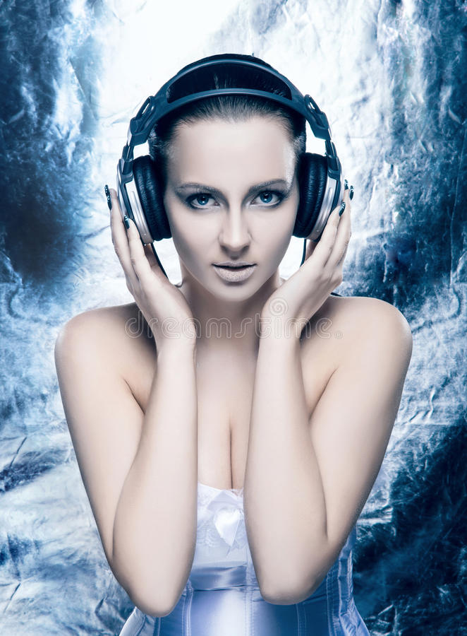 Portrait of a young woman in headphones and makeup stock photos