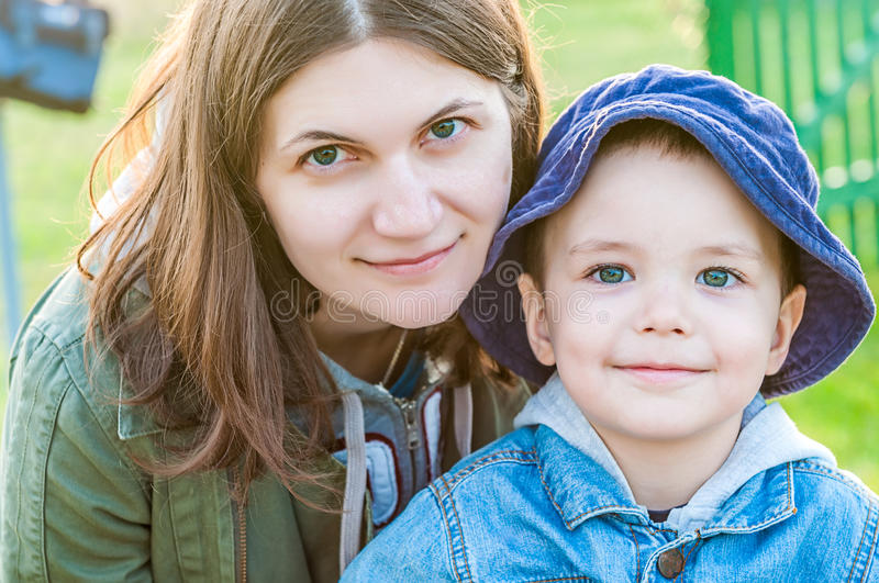 Portrait of young woman and her boy stock photos
