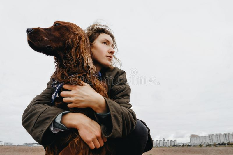 Portrait of a young woman with her dog. stock photo