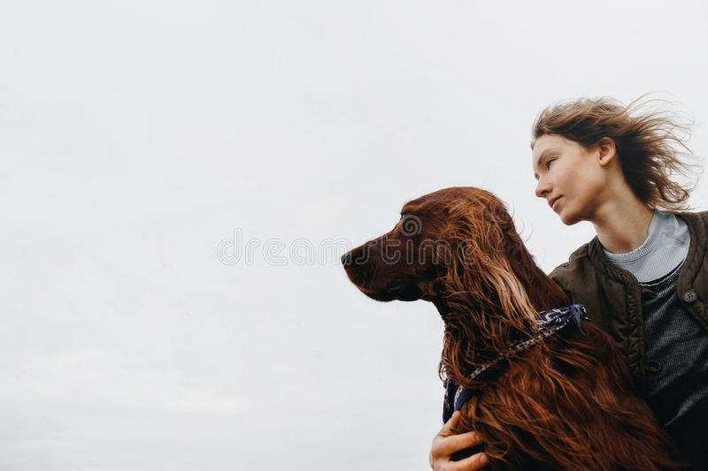 Portrait of a young woman with her dog. royalty free stock photography