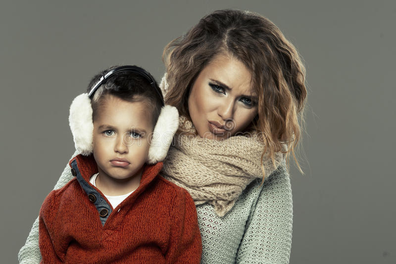 Portrait of a young woman with her son royalty free stock image