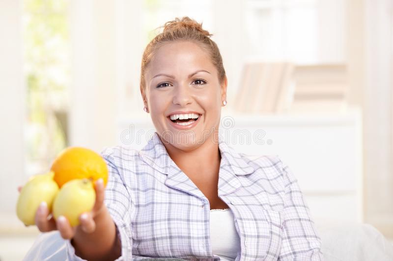 Portrait Of Young Woman Holding Lemons In Hand Stock Photos