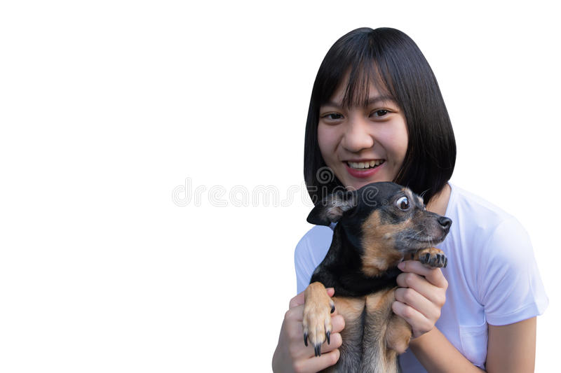 Portrait of a young woman holding a little black dog. stock image