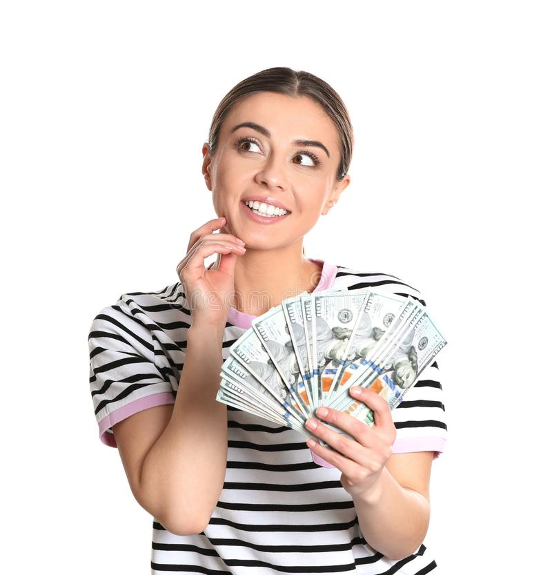 Portrait of young woman holding money banknotes. On white background royalty free stock photos