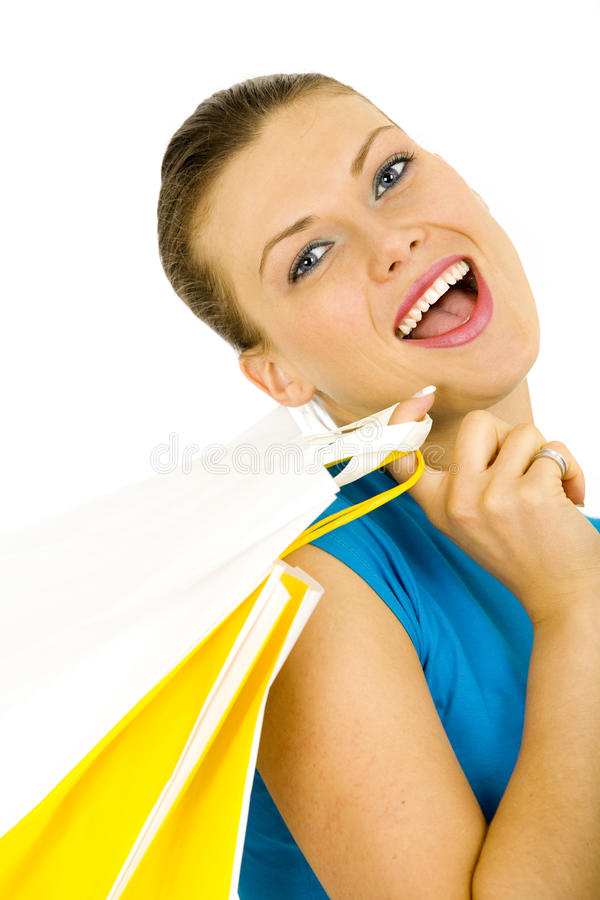 Portrait of a young woman holding shopping bags stock photos