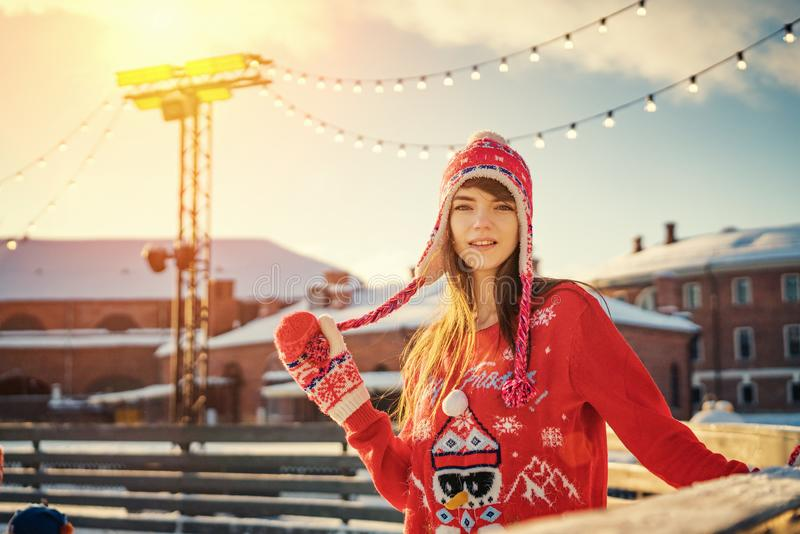 Portrait of a young woman on the ice rink, a smile on his face, the sun royalty free stock images