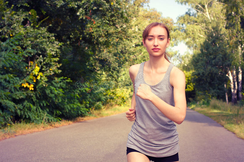 Portrait of young woman jogging . royalty free stock photos