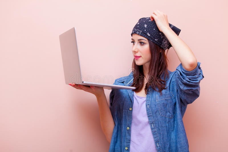 Portrait of a young woman with laptop stock images