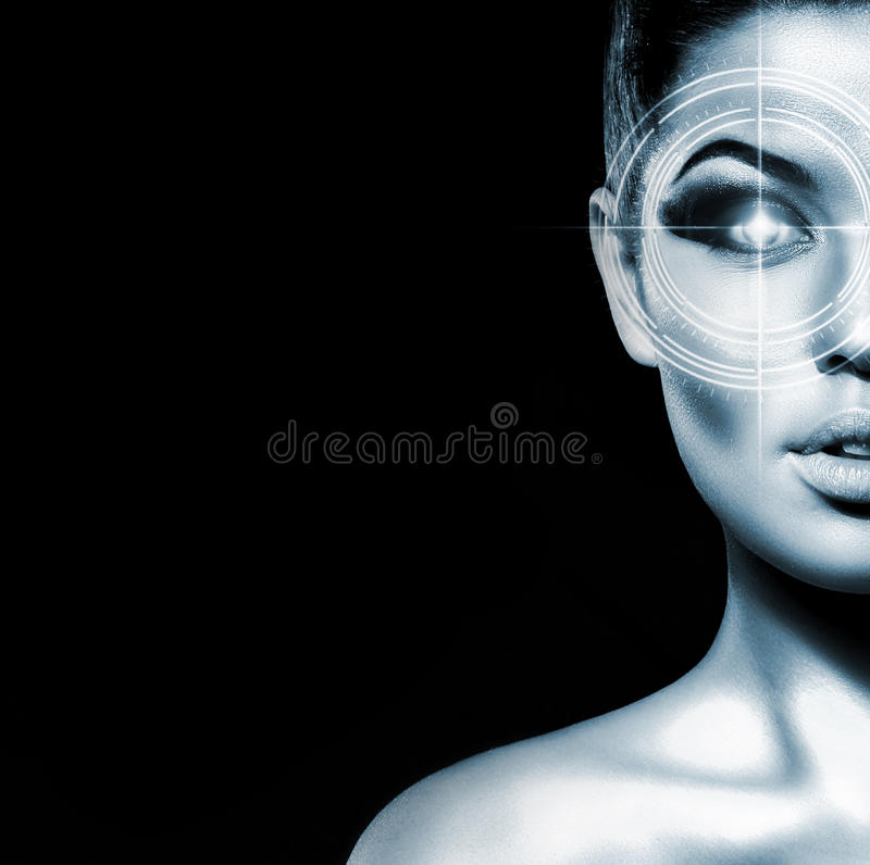 Portrait of a young woman with a laser on her eye. Hi-tech portrait of a young and attractive woman with a holographic element on her eye. (Laser medicine and stock images
