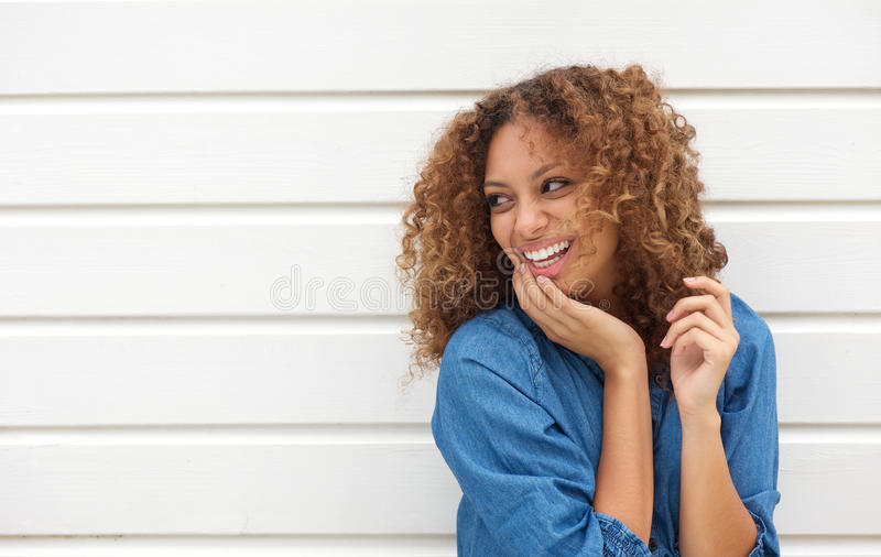 Download Portrait Of A Young Woman Laughing And Looking Away Stock Photo - Image: 34391498