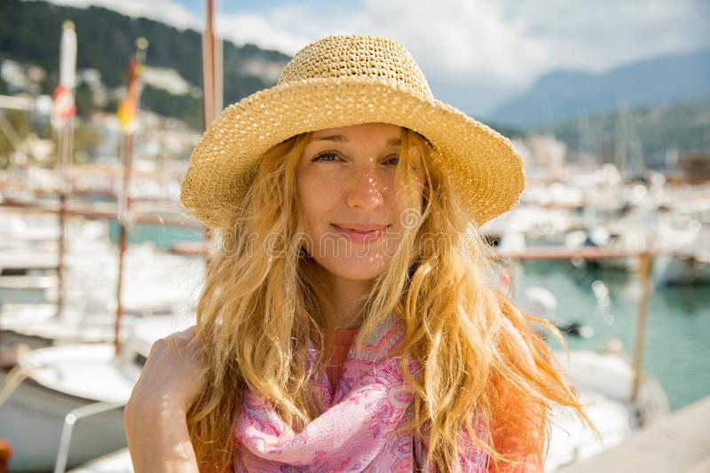 Portrait of young woman with light curly hair in straw hat stock photos