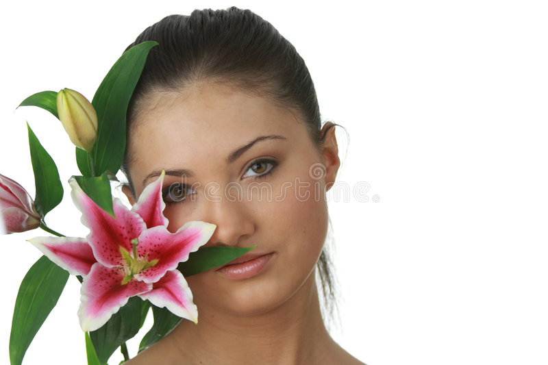 Portrait of young woman with lilly flower stock photography