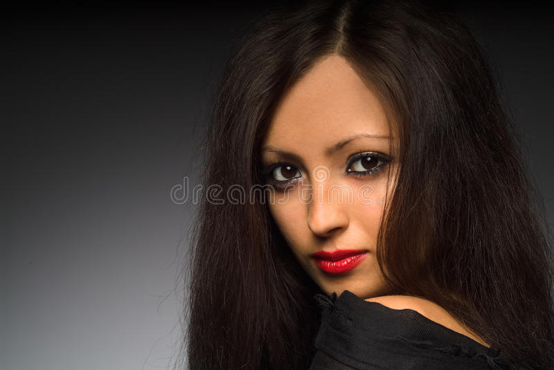 Portrait of an young woman with long hair. stock photos