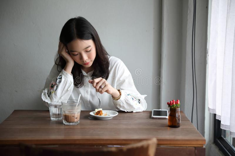 Portrait of young woman in coffee shop modern life style royalty free stock images