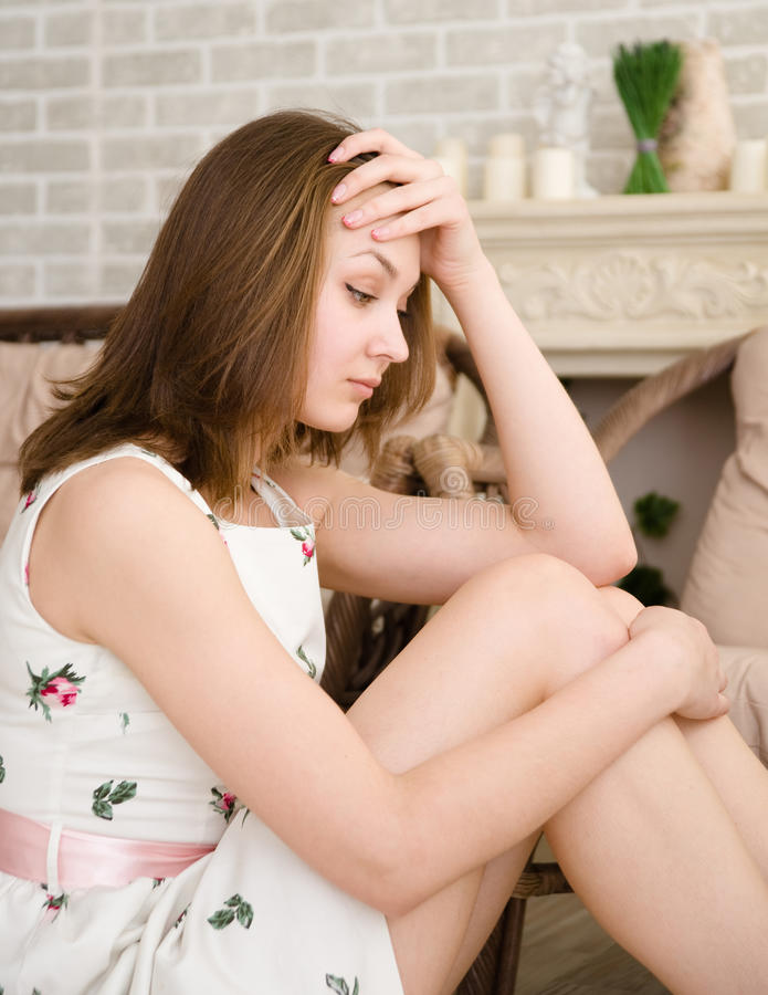 Download Portrait Of A Young Woman Looking Depressed. Stock Photo - Image: 40402938