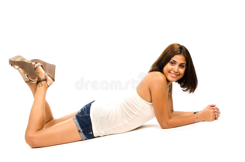 Portrait Of Young Woman Lying On Floor Smiling And Looking At Yo Stock Images
