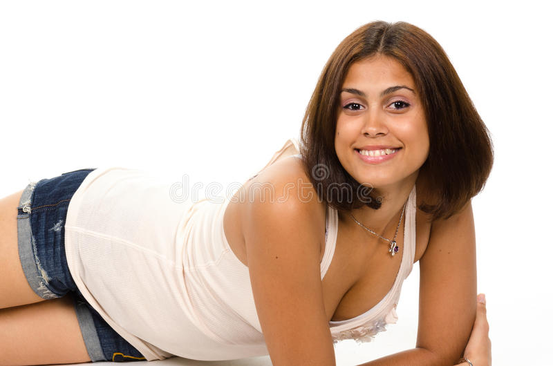 Portrait of young woman lying on floor smiling and looking at yo